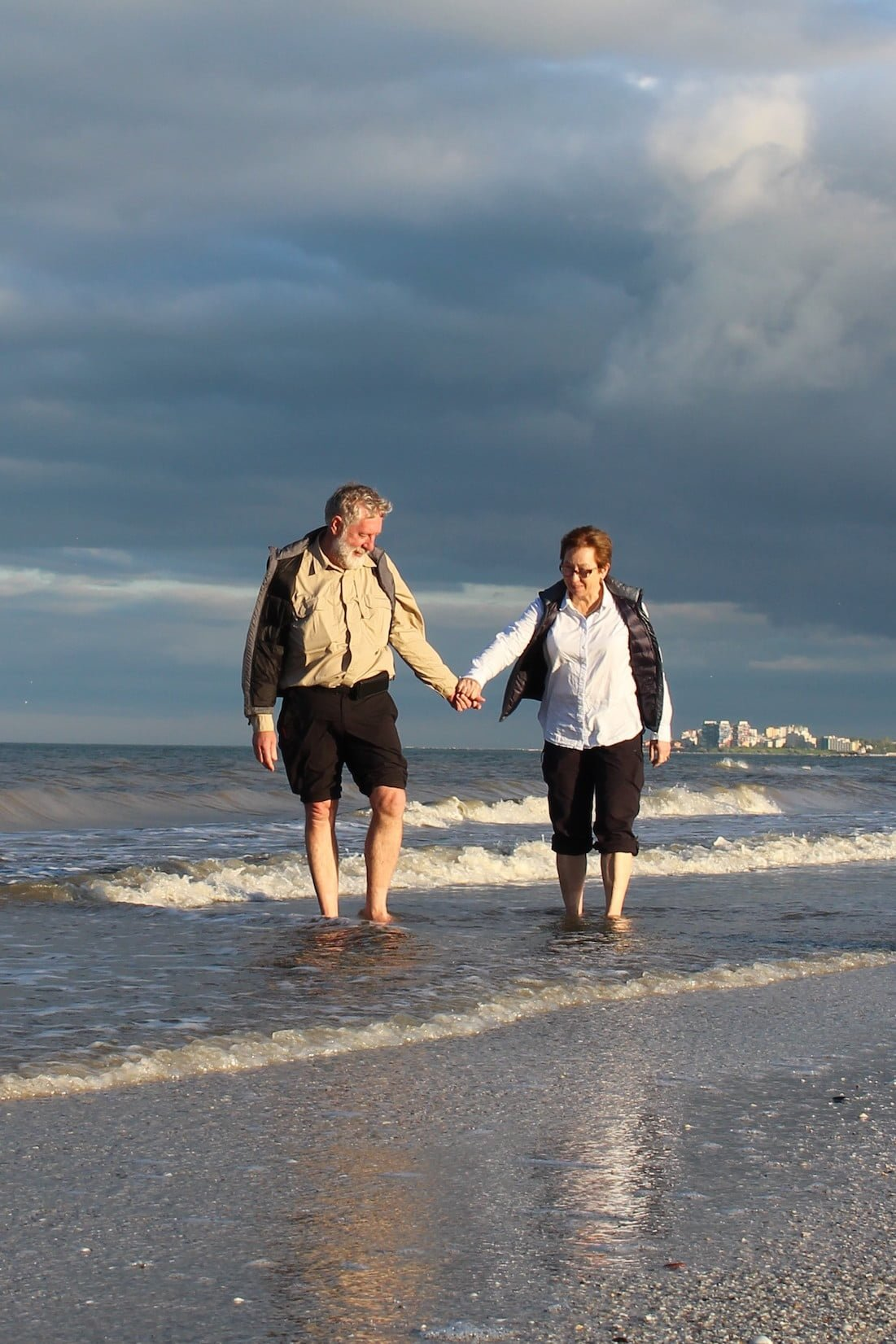 Michael and Helen Moore dipping their feet in the Black Sea